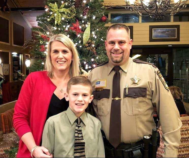 Reserve Deputy Mike Fatland with wife Sara and son Ryan